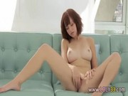 Brunette testing glass dildo